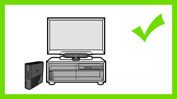 A Kinect sensor is positioned in front of a TV on a cabinet that has glass doors. A check mark is next to the image.