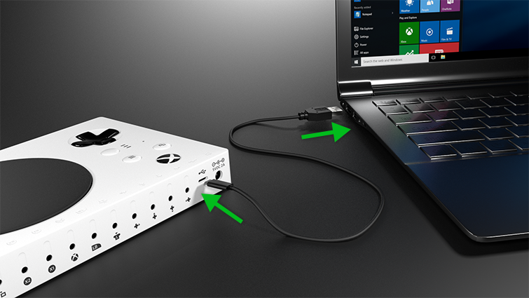 USB-C cable plugs into back of Xbox Adaptive Controller and other end plugs into PC