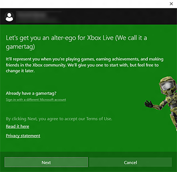 The Xbox app screen that describes a gamertag also includes buttons for Next and Cancel plus a link to sign in with a different Microsoft account.