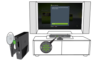 An Xbox set-up screen is displayed on a TV, while a disc is inserted into the disc tray of an Xbox console next to the TV.