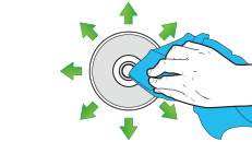 A hand wipes a cloth on a disc, with arrows pointing outward from the center.