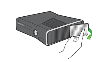An illustration shows the location of the hard drive door on the Xbox 360 E console.